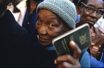 A woman holds her identity papers before casting her ballot at a polling station in Soweto.    Millions of South Africans voted in the nation's first free and democratic general election,  marking the end of centuries of apartheid rule.  Nelson Mandela of the African National Congress (ANC) was elected as the first black President of South Africa.