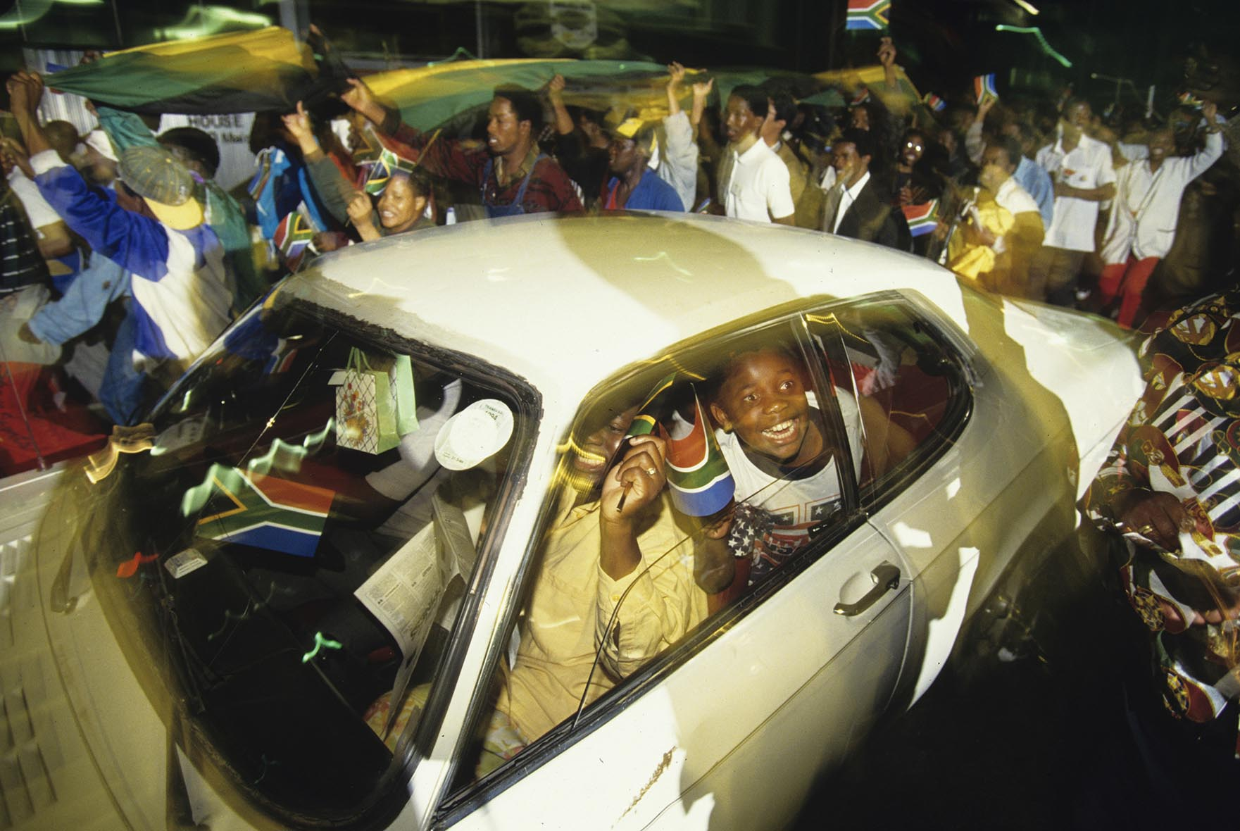 Supporters of Nelson Mandela celebrate his victory as the first black President of South Africa.   Millions of South Africans voted in the nation's first free and democratic general election,  marking the end of centuries of apartheid rule.