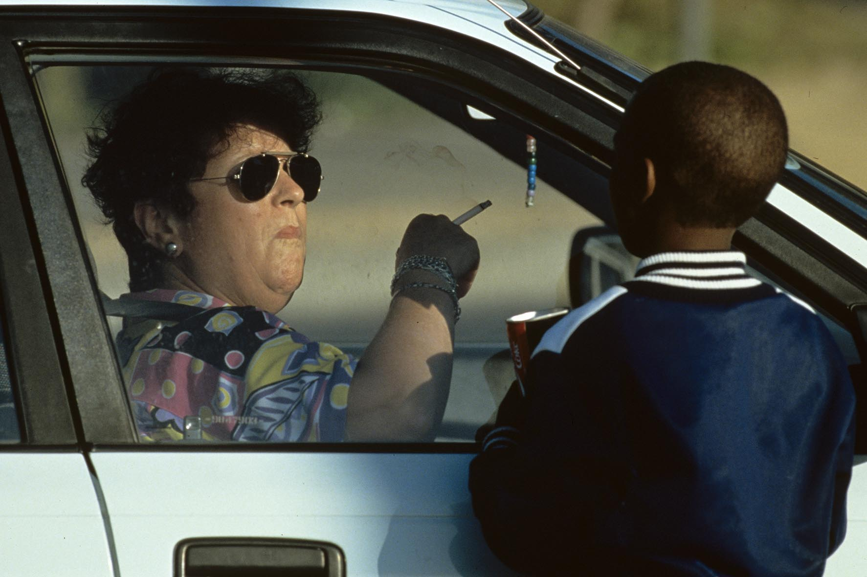 A young child looks for money from a motorist in Cape Town, South Africa.  The disparity between rich and poor is evident in the popular African tourist city.
