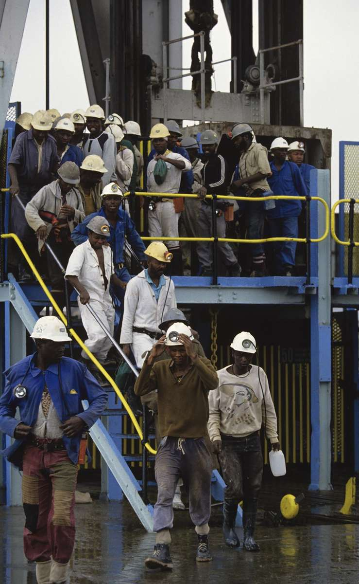 Works leave after a shift at Kinross Gold Mine in South Africa.