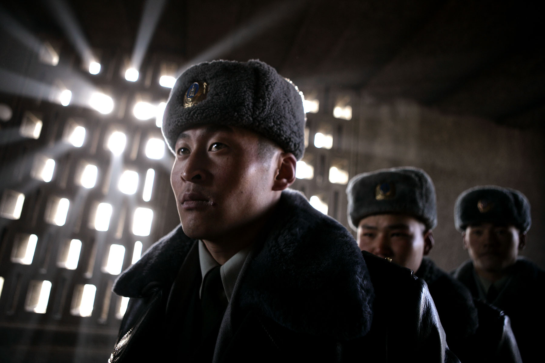 Soldiers from the Mongolian Army wait outside the Government House for the arrival of U.S. President George W. Bush's, Monday, Nov. 21, 2005 in Ulan Bator, Mongolia.Photo by Brooks Kraft/Corbis