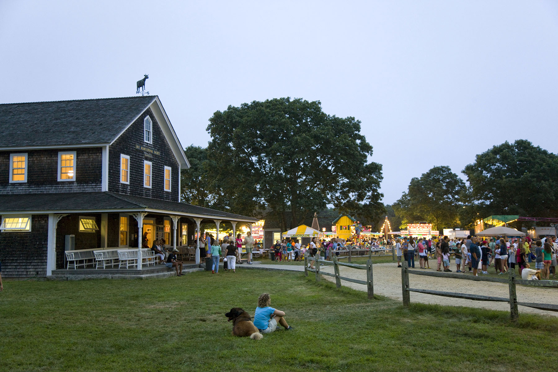 Fair goers at the 147th annual Martha's Vineyard Agricultural Society Fair.   The annual event brought traditional livestock contests, racing pigs, rides and more to island off Cape Cod in Massachusetts. Photo by Brooks Kraft/Corbis