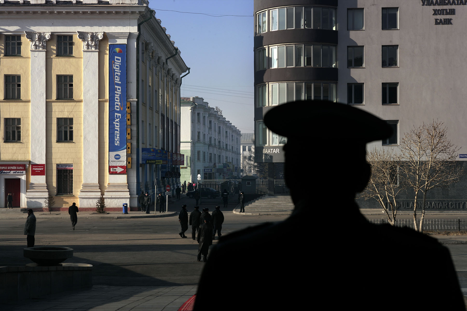 A Soldier from the Mongolian Army watches outside the Government House as preparation were underway for U.S. President George W. Bush's visit, Monday, Nov. 21, 2005 in Ulan Bator, Mongolia.Photo by Brooks Kraft/Corbis