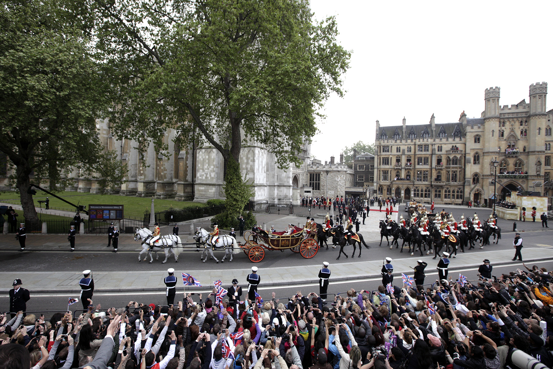 Britain's Prince William and his wife Catherine, Duchess of Cambridge,  leave after their wedding in Westminster Abbey in the 1902 State Landau along the Procession Route, in central London.