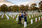 On Veterans Day a group gathers at a grave site of a loved one in Section 60 of Arlington National Cemetery.    Section 60 is a 14-acre plot that where over 1,000 people killed in the recent wars of Iraq and Afghanistan are buried.
