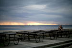 A man drinks a beer at a cafe along the Gulf of Finland in St. Petersburg, Russia, July 17, 2006.Photo by Brooks Kraft/Corbis
