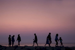 People along the jetty at sunset in Menemsha in the town of Chilmark on Martha's Vineyard.   Photo by Brooks Kraft/Corbis