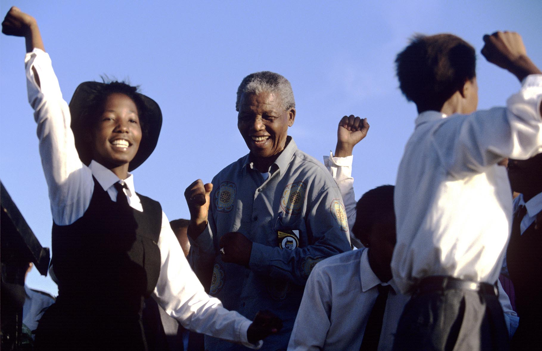 Nelson Mandela dances with school children at a campaign event. After more then 27 years in jail as an anti-apartheid activist,   Nelson Mandela lead a 1994 campaign for President as a member of the African National Congress (ANC),  in the first free elections in South Africa in 1994.  Mandela has received more than 250 awards over four decades, including the 1993 Nobel Peace Prize.