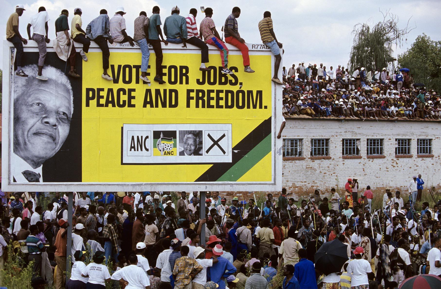Supporters listen to Nelson Mandela at a campaign event.   After more then 27 years in jail as an anti-apartheid activist,   Nelson Mandela lead a 1994 campaign for President as a member of the African National Congress (ANC),  in the first free elections in South Africa in 1994.  Mandela has received more than 250 awards over four decades, including the 1993 Nobel Peace Prize.