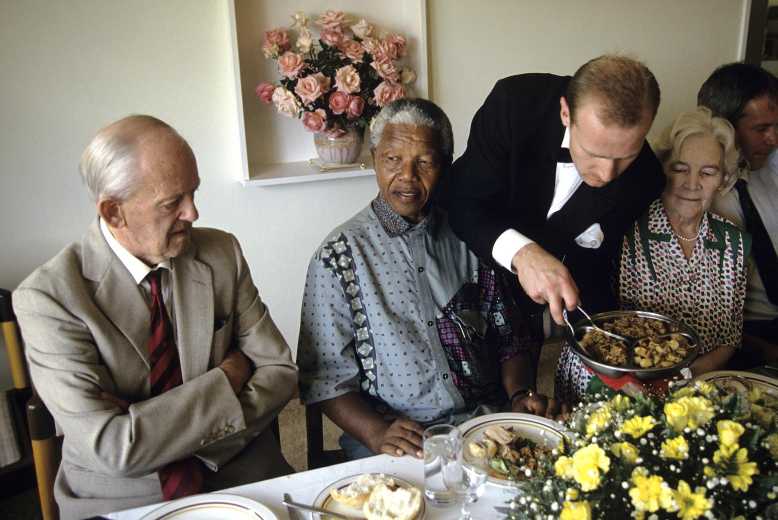 Nelson Mandela is served lunch at the home of a wealthy white land owners during his campaign for President.  After more then 27 years in jail as an anti-apartheid activist,   Nelson Mandela lead a 1994 campaign for President as a member of the African National Congress (ANC),  in the first free elections in South Africa in 1994.  Mandela has received more than 250 awards over four decades, including the 1993 Nobel Peace Prize.