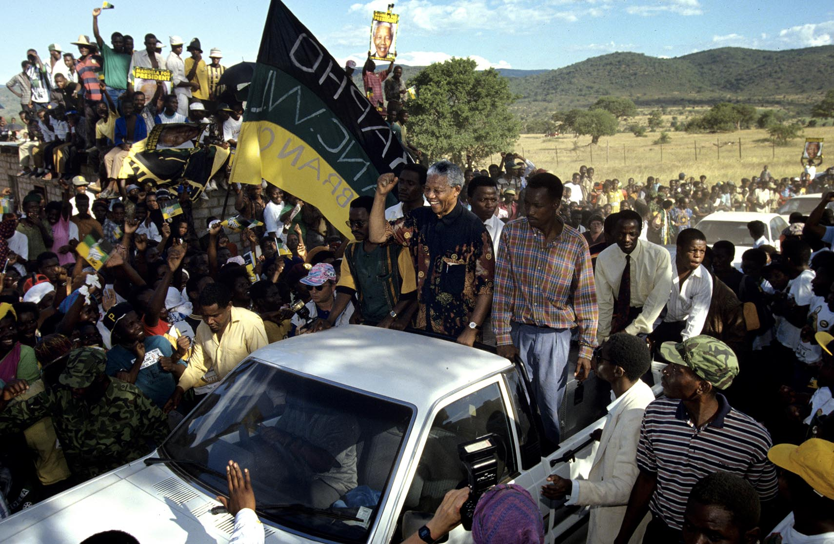 Nelson Mandela greets supports at a campaign stop. After more then 27 years in jail as an anti-apartheid activist,   Nelson Mandela lead a 1994 campaign for President as a member of the African National Congress (ANC),  in the first free elections in South Africa in 1994.  Mandela has received more than 250 awards over four decades, including the 1993 Nobel Peace Prize.