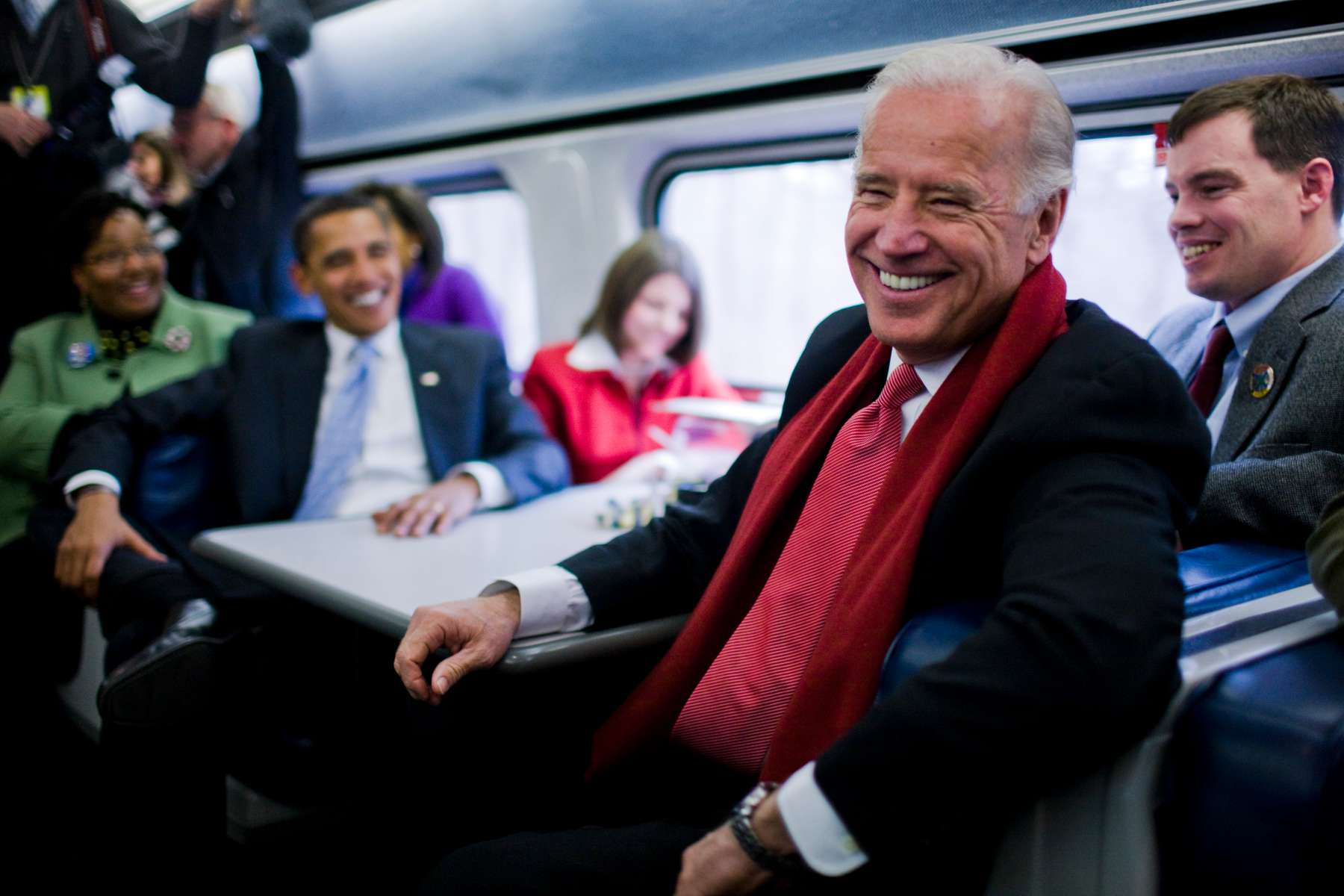 Vice President elect Joe Biden and President-elect Barack Obama speaks with passengers on the train en route to Baltimore, during his inaugural whistle stop train trip to Washington.  Photo by Brooks Kraft/Corbis