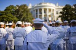 A military honor guard salutes during an arrival ceremony on the South Lawn of the White House in Washington.
