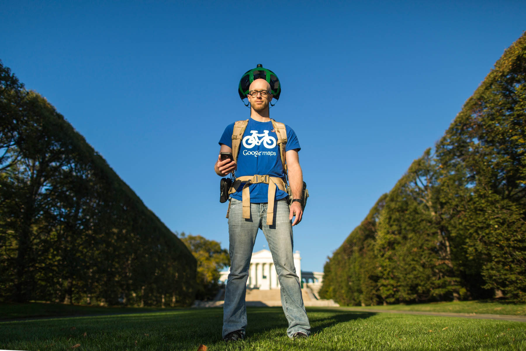 A Google employee walks thru Arlington National Cemetery with the Street View capture device known as the Trekker,  a wearable backpack system that has 15 cameras.  Each lens in the Trekker backpack points in a different direction, so that when combined, all of the images can be stitched into 360-degree panoramic views.  Once Google is done mapping, which is planned for the cemetery's 2014 150th anniversary, armchair travelers can visit the iconic graveyard online,  and explore both panoramic and detailed views of the hollowed grounds.