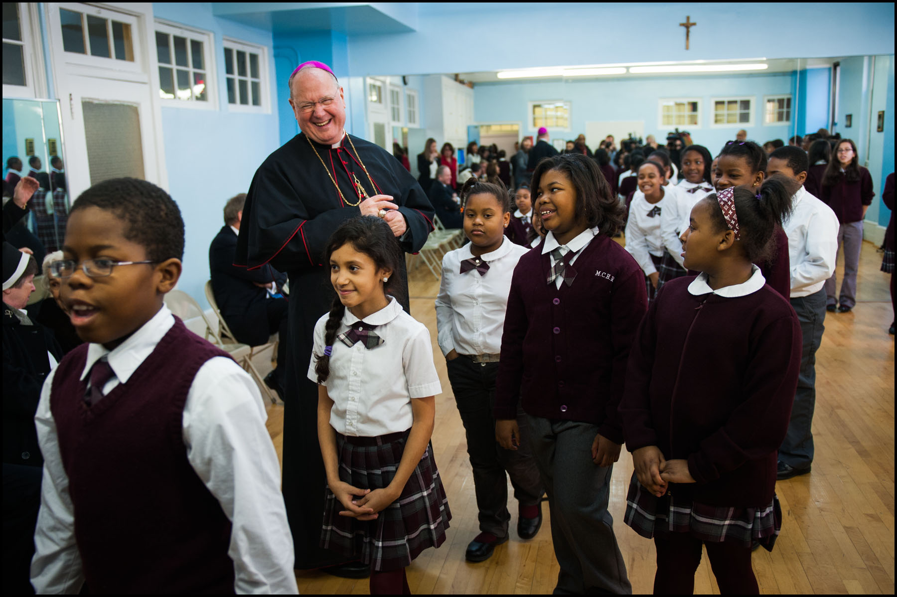 Archbishop Timothy Dolan is overjoyed with the children while taking a tour of the Mount Carmel- Holy Rosary school.