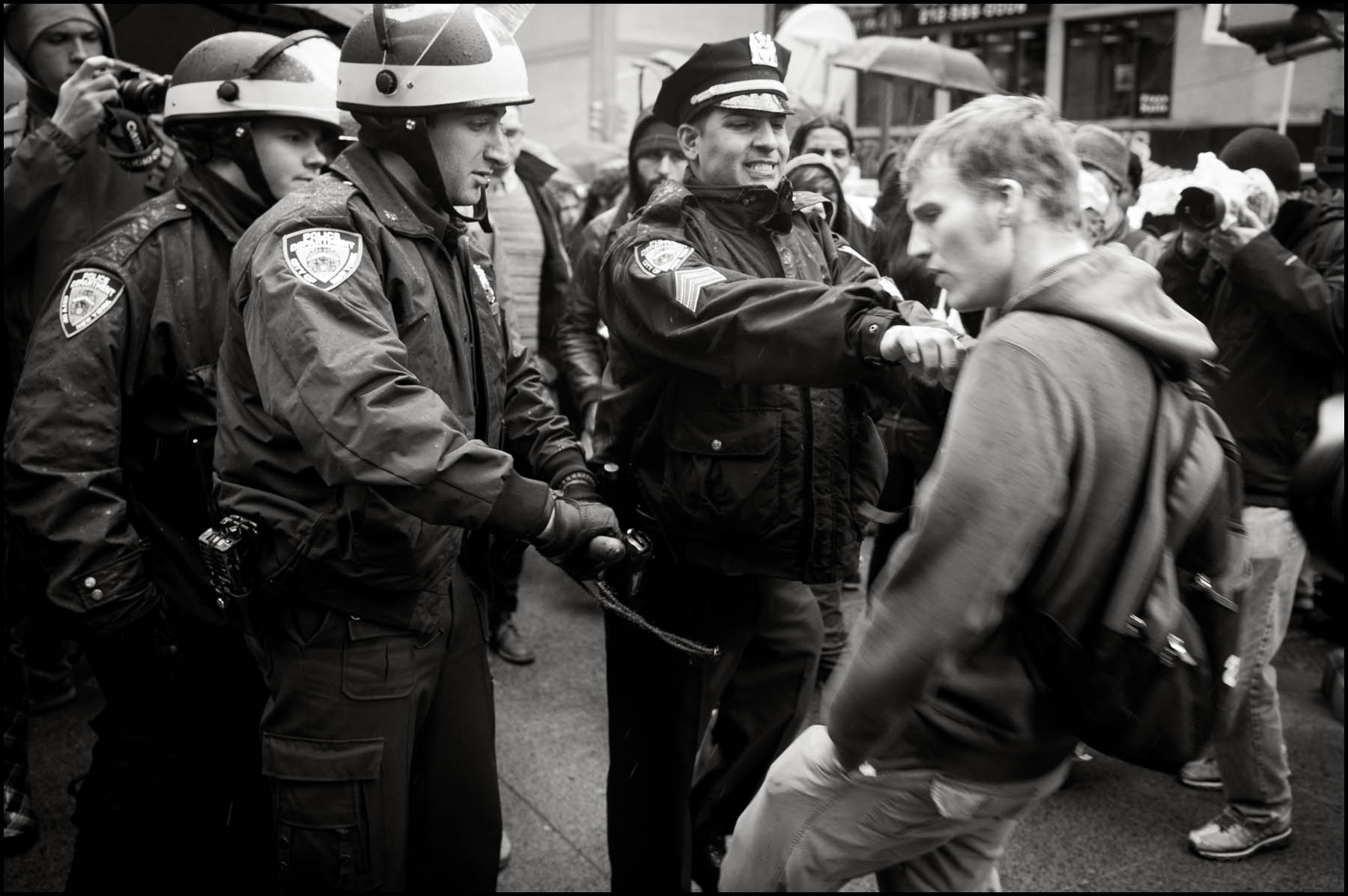 A police officer shoves a protester for not backing up quick enough Thursday in Zuccotti Park.
