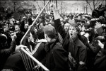 Protesters rip up police barricades in Zuccotti Park during a day of mass action.