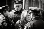 A young girl pleads with police as a group of Occupy Wall Street protesters get arrested in front of Goldman Sachs headquarters in Battery Park City after they held a mock trial against the company.