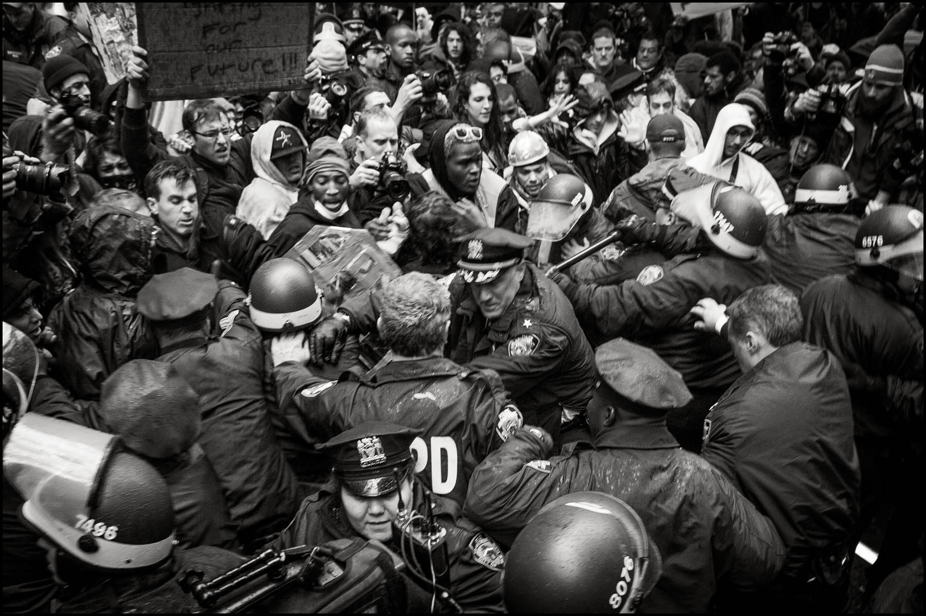 A large fight breaks out in Zuccotti Park between Police and protesters after a protesters took an officers cap.,