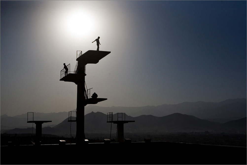 On a hill overlooking Kabul, Afghanistan, sits an Olympic-size pool built by the Soviets in the 1980s. It is said that the Taliban forced criminals off the platforms to their deaths at the bottom of the pool, August 2009.