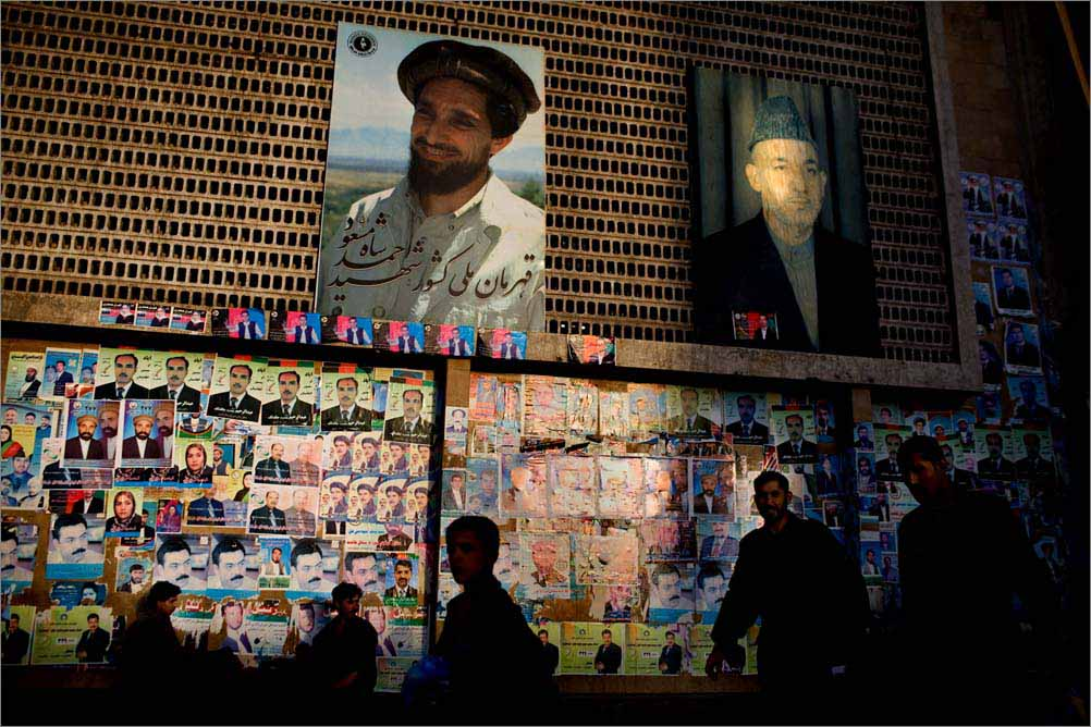 "In central Kabul, Afghanistan, a poster of President Hamid Karzai is hung next to the image of Ahmad Shah Massoud, a legendary ant-Soviet resistance leader known as the ""Lion of Panjshir"", August 2009."