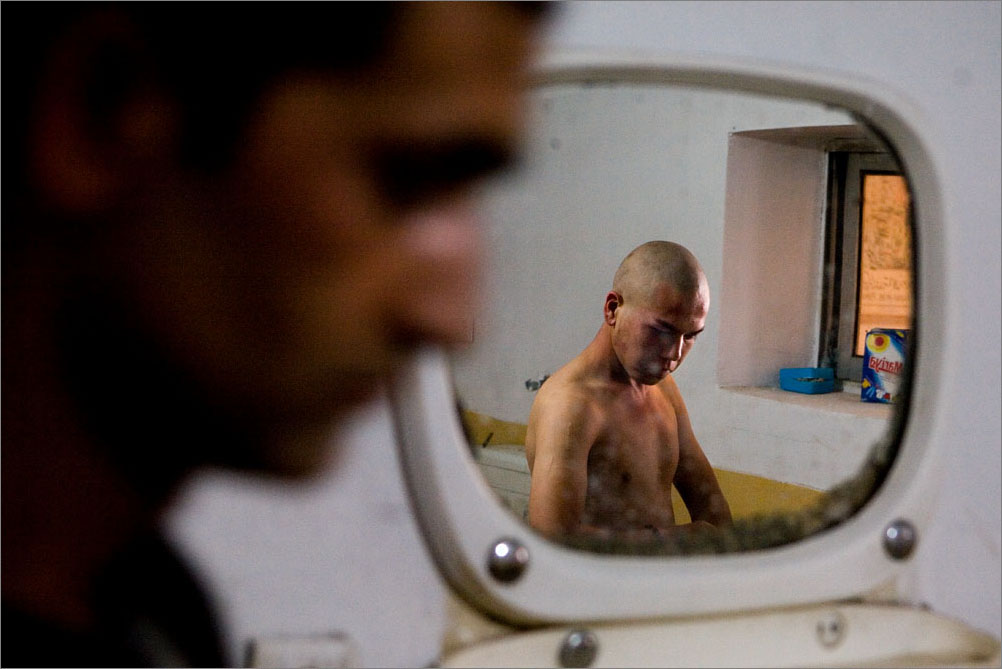 At the Nejad Center in Kabul, Afghanistan, a man has just had his head shaved on his first day of rehab, August 2009.