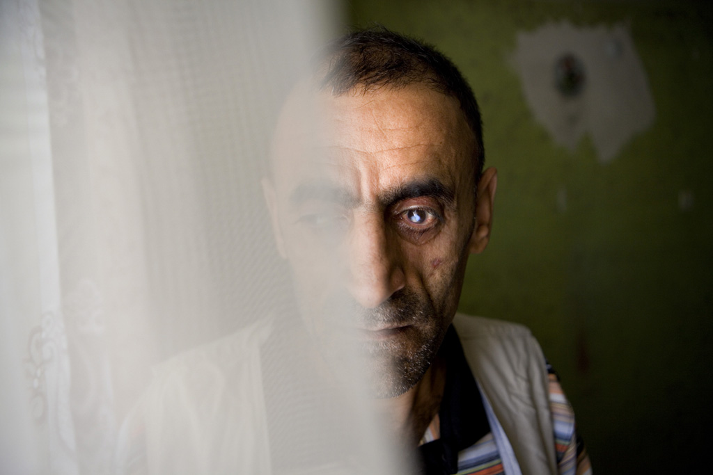 Hekim Ipek, whose two brothers Ikram and Servet were {quote}disappeared{quote} by the Turkish military in 1994, stands in his home in Diyarbakir, August 2009.