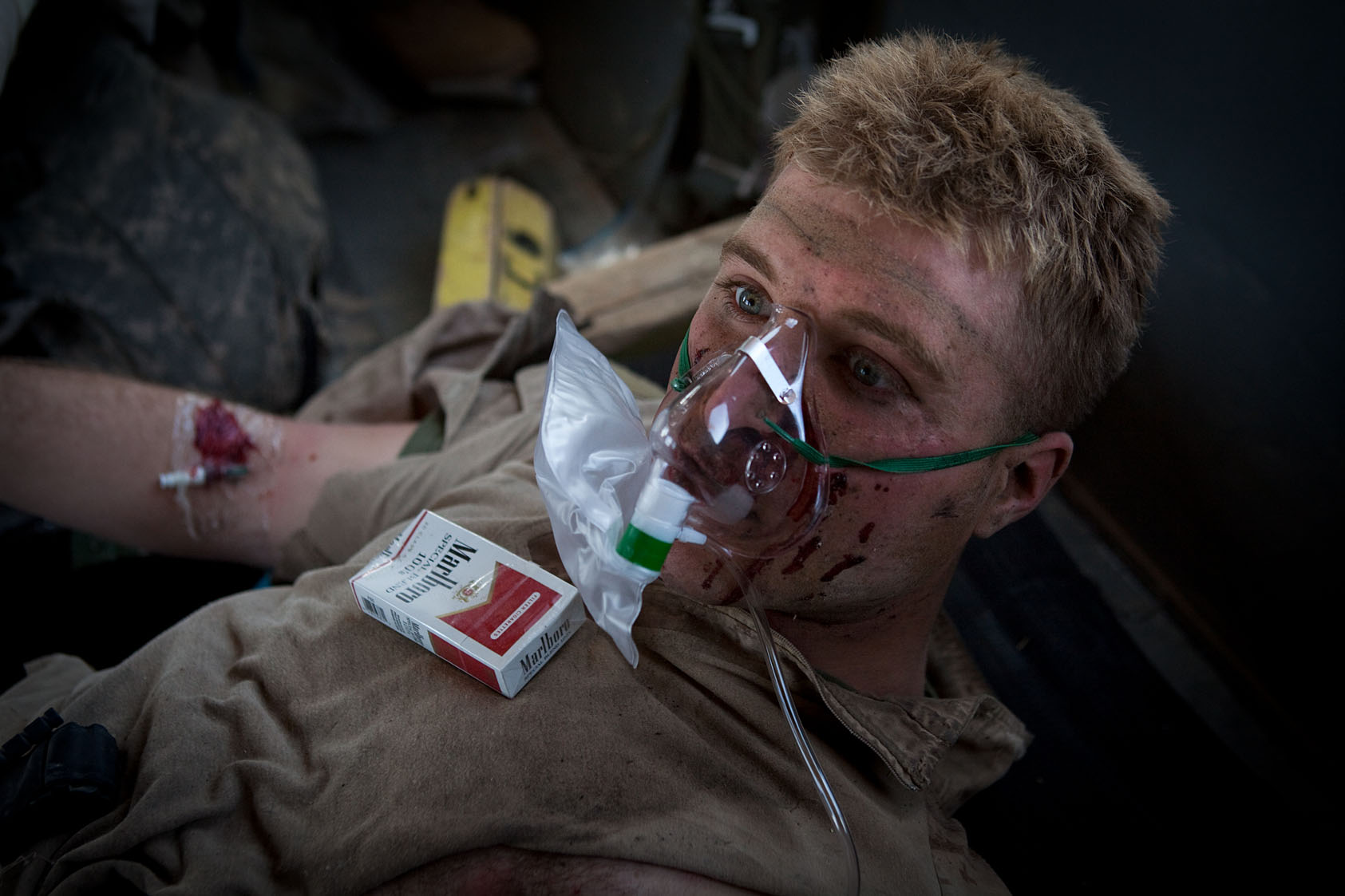 A Marine wounded by an improvised explosive device is cared for in a medevac helicopter in southern Helmand Province, Afghanistan, November 30, 2010.
