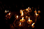 Candles burn outside a temply in Kathmandu.