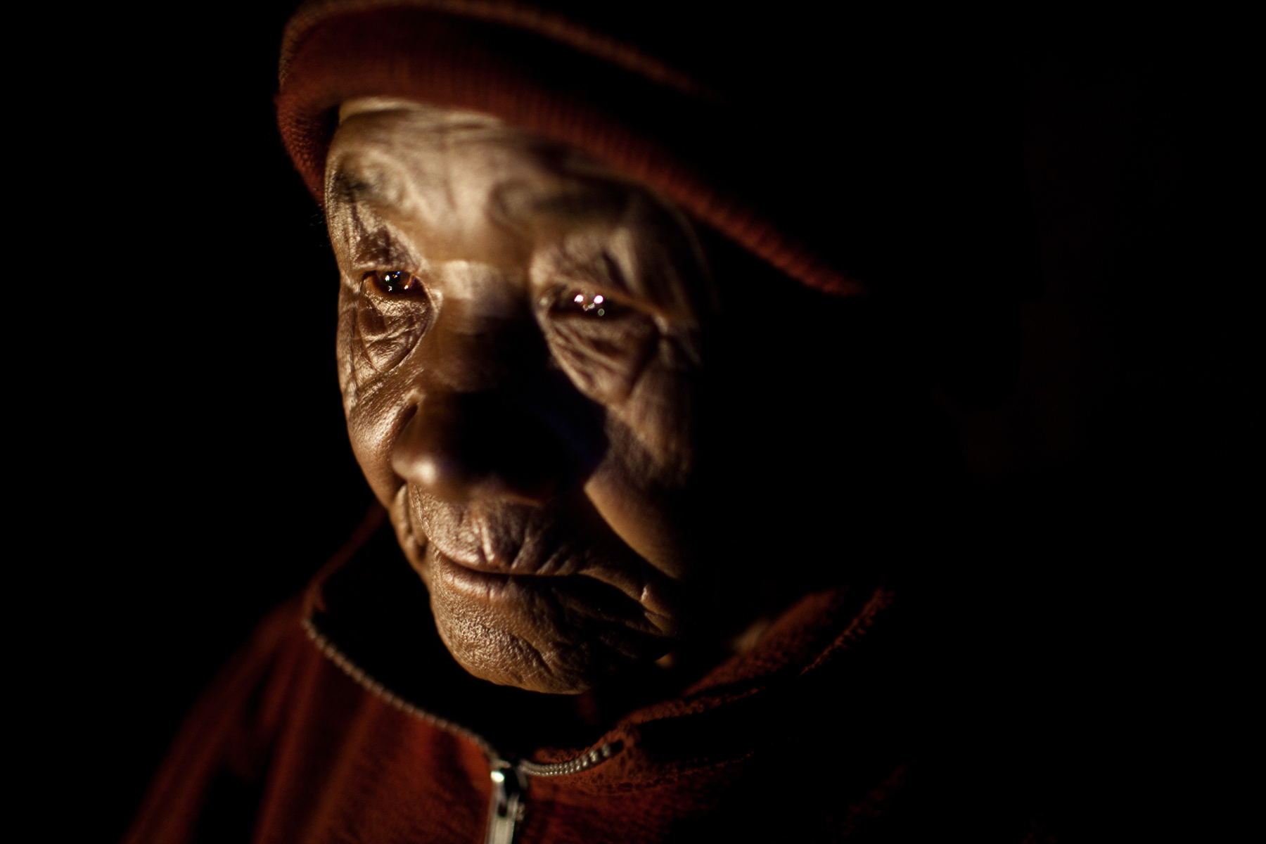 A portrait of an elderly nun living in Thame, a remote village in north-western Nepal.
