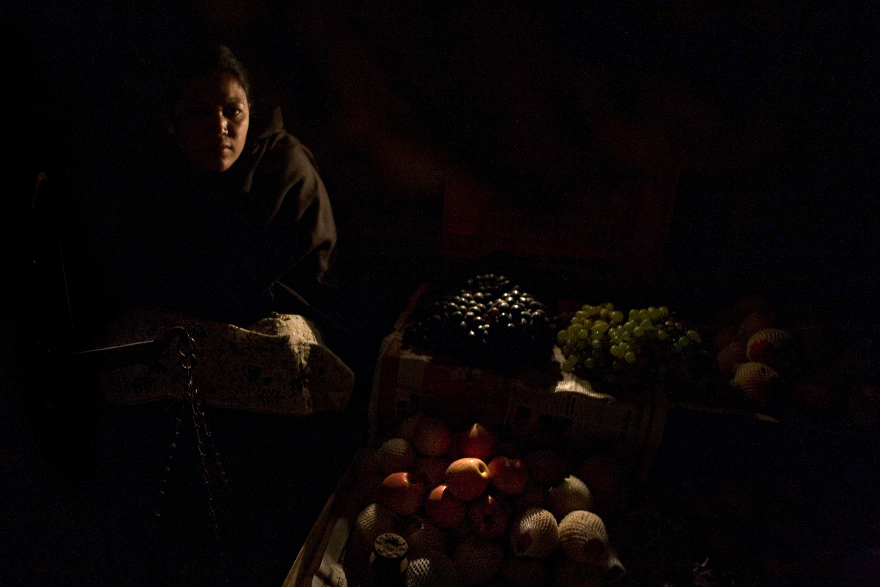 {quote}Ruchi{quote}, a mother of five, sells fruit on the side of the road leading out from Kathmandu, Nepal.