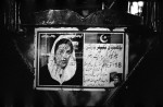 The defaced image of former opposition leader Benazir Bhutto affixed to the back of a rickshaw in Karachi.  Bhutto's widow, Asif Ali Zardari, is now president of Pakistan.