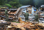 Japan's self-defense army searches among tsunami damaged wreckage at Hamagurihama in Ishinomaki, Miyagi prefecture.