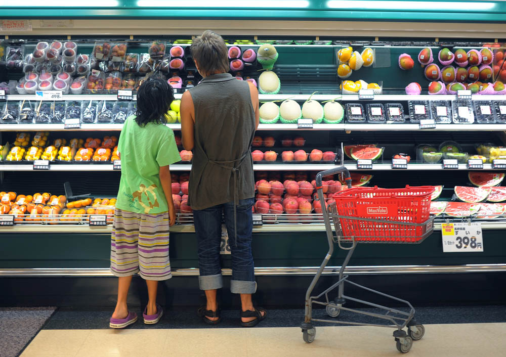Takaki Hara (38),right, and Rukiya (12),left, share an intimate moment during grocery shopping at a supermarket nearby. Kawasaki city, Kanagawa prefecture. August 13, 2011.