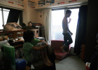 Takaki Hara (38),right, becomes a bit upset about his son Rukiya's disorganized room because Rukiya (12), left,is on summer break and starts leading a loose life.  Kawasaki city, kanagawa prefecture. August 13, 2011.