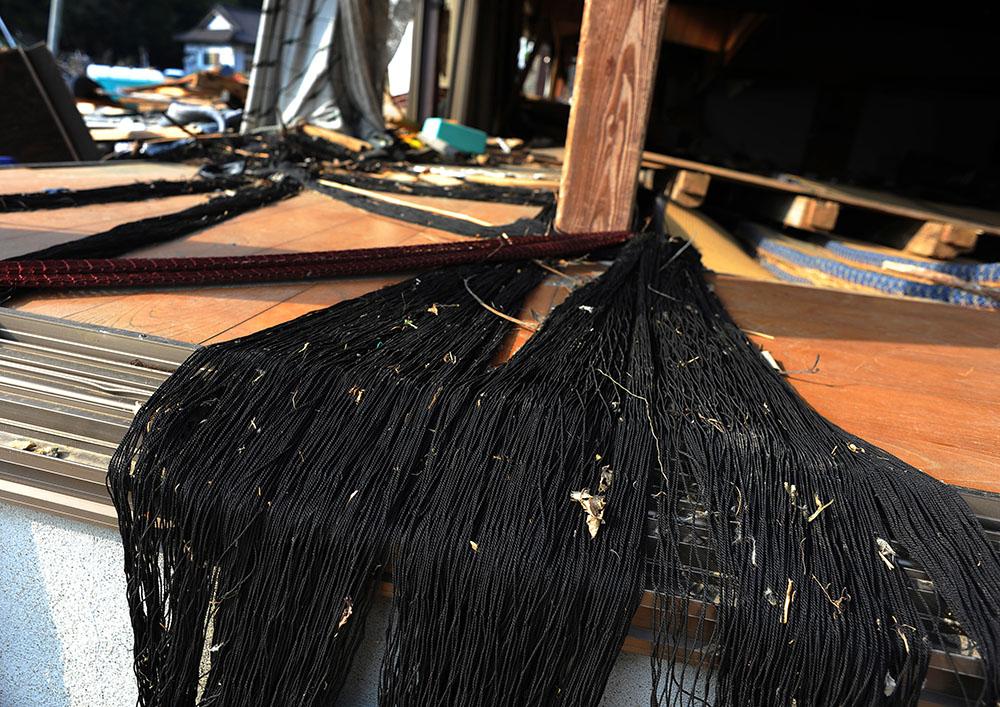 Fishing net left stranded at the house of Hamagurihama in Ishinomaki, Miyagi prefecture.