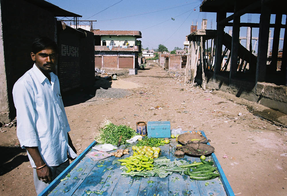 A vegitable vendor at Jai Prakash Nagar,one of the heavily affected slums in 1984. The bustee has been rebuilt little by little since then.Both Hindu and Muslim groups live together very peacefully.