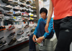 Li Chuan-hua goes on a shopping spree with his wife at a fashion district of Lin Yi-City, Shandong Province, China.