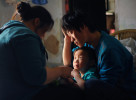 Wu Yan (32), cuts her son's Li Jia-yi (5) nails at home. Li Chua-hua shares their tender moment.