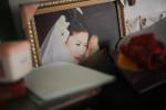 Li Chua-hua and Wu Yan's wedding portrait picture in their bedroom.