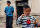 Li Jia-yi (5) blows soap bubbles in the courtyard of their house while Li Chuan-hua wears sunglasses bought as his own souvenir at duty free shop in Chubu Centrair International Airport, Nagota, Japan. Lin Yi-City, Shandong Province, China.