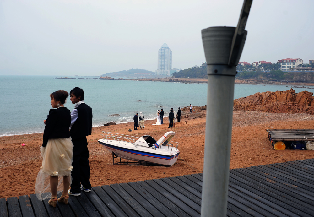 Newly-wed couples for massive photo shoot-out, Qingdao, Shangdong province, China.