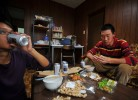 Li Chuan-hua ,27, right, and his co-worker&supervisor,Su Li-li,25, left, share a bond of friendship in their living room on a Sunday afternoon with 6 pack of Low-molt beer which is the cheapest alcohol beer available in Japan. Sunday is their only day off.