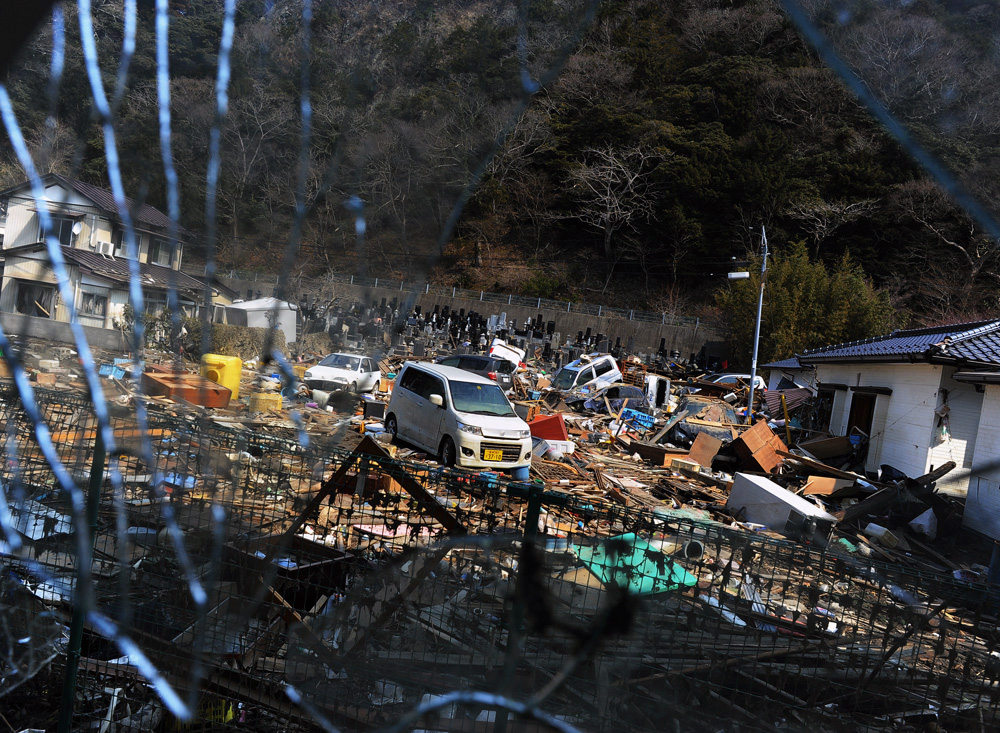 A view of the devastated residential area and cemetery of {quote}Jion-in{quote}  from Minato elementary school evacuation center in Ishinomaki, Miyagi prefecture.