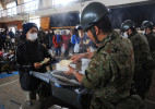 Japan's self-defense army distributes emergency foods to the evacuee at Minato elementary school evacuation center in Ishinomaki, Miyagi prefecture.