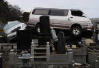 Car sit on headstones in the cemetery of {quote}Jion-in{quote} ,Ishinomaki, Miyagi prefecture.