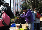 Masayoshi Suzuki (54) distributes emergency rations to the people of Sendai, Miyagi prefecture at Itsuzubashi-park although he has been homeless and stays at the NPO's temporary shelter.