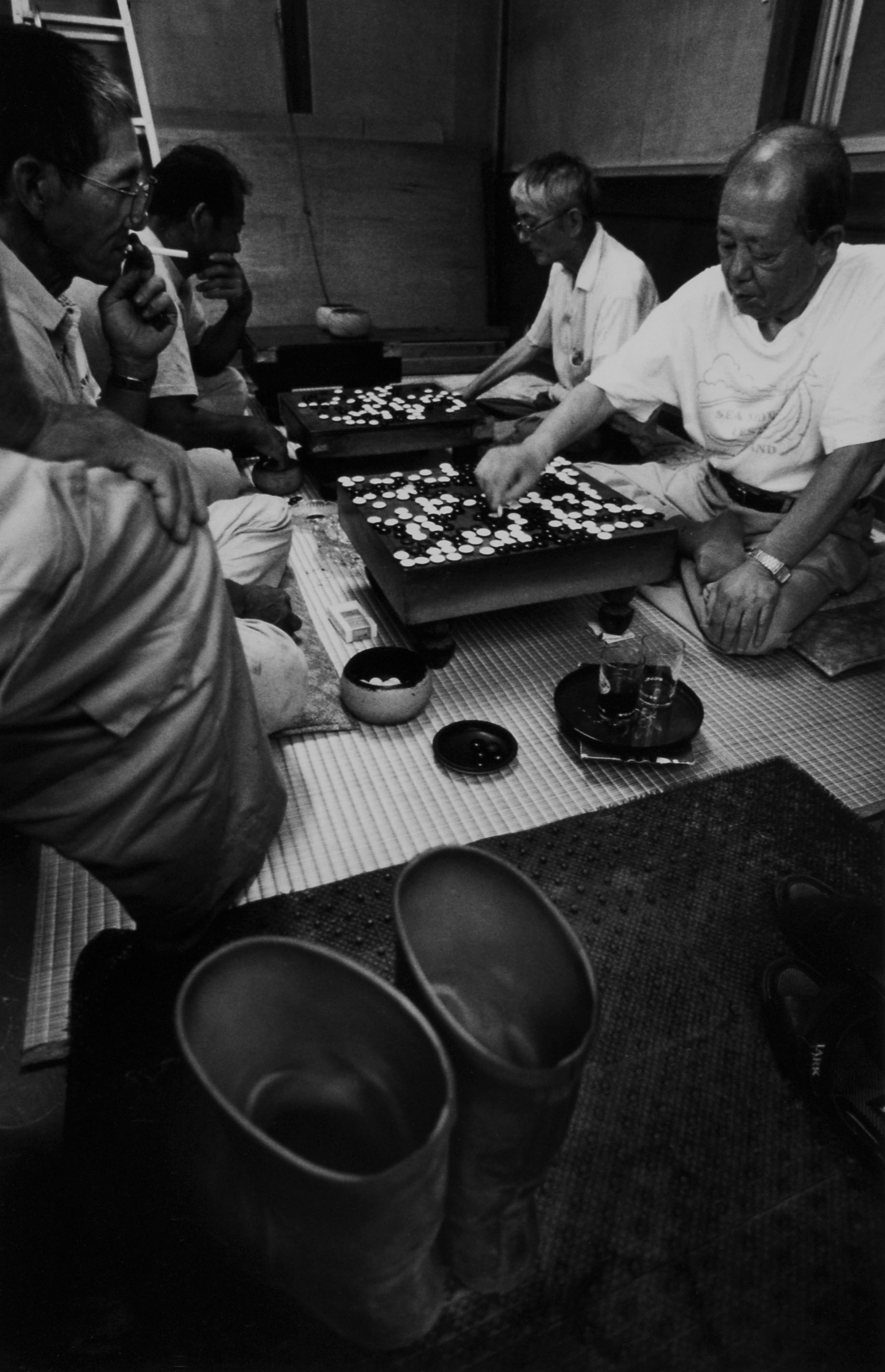 The locals play Go game after work in a room next to Takahashi barbershop, Nakanogo district.