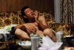 Li Chuan-hua gets drunken with a puff of smoke in a living room  after work. He starts smoking Japanese cigarette brand called {quote}Echo{quote} which is cheaper than the other brands. {quote}I start drinking and smoking heavily.I don't want my wife in China to find this!{quote} he laughed to himself.