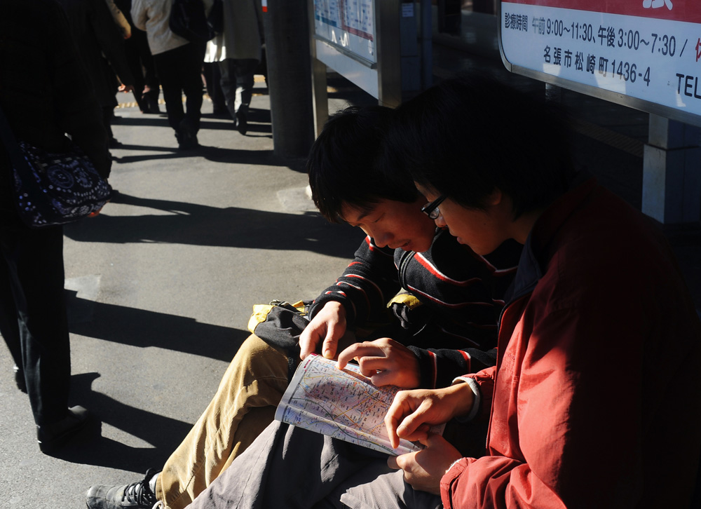 Li Chuan-hua checks the route to Mie University where  the Japanese Language Proficiency Test  takes place at Nabari train station in December 2010 with Su Li-li who decides to accompany him in part to see his Chinese friend at Mie University.